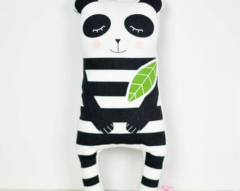 panda cloth doll in black and white stripes with green leaf