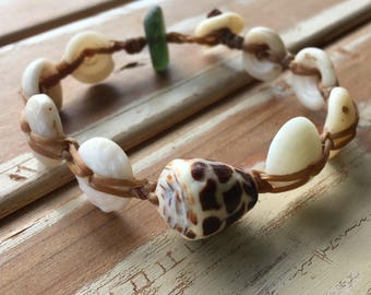 Hebrew cone shell with puka shell bracelet