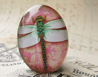 Green dragonfly on pink wallpaper, handmade glass oval cabochon, 40x30mm or 25x18mm Winged Wonder collection