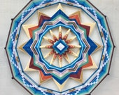 Red Rock Sun, a 24 inch, wool yarn, Ojo de Dios, by S. Herbert