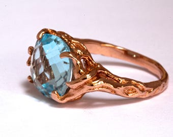 14k  rose gold Swiss Blue Topaz tree ring holding up the moon  NYC Blue Bayer Design