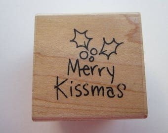rubber stamp - Merry KISSMAS - Stampendous C187 - used rubber stamp - 2006