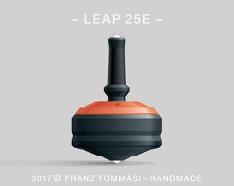 LEAP 25E Orange-on-Black Spin Top with rubber grip, dual ceramic tip, and accent holes (3)