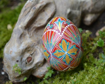 Pysankain red and blue decorated Easter egg batik work Folk Art Ukrainian traditional Easter eggs