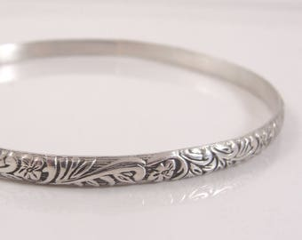 Sterling silver floral and fern bangle