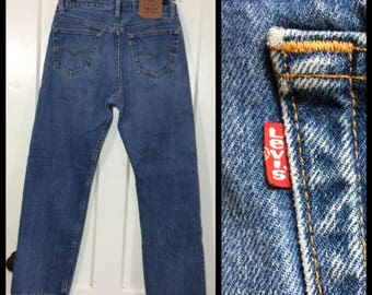 1980s Levis 501 faded denim blue jeans 34X30, measures 32x29 straight leg button fly made in USA boyfriend #337