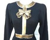 25 % de réduction vente Vintage Pat Sandler pour Wellmore à Saks Fifth Avenue noir et paillettes d'or tricot vacances cocktail robe taille S M