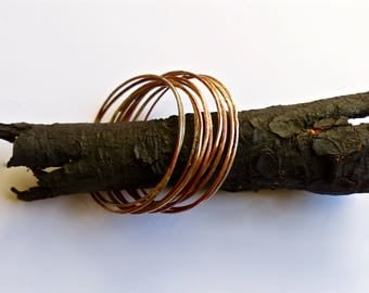 Bracelets to stack in copper and silver fused clumps.
