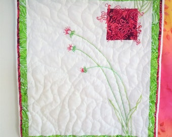 Fuchsia and green fiber art floral wall hanging, embroidered, beaded