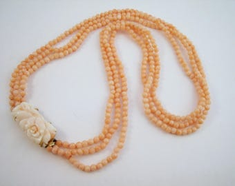 Angel skin coral necklace, triple strand with beautifully carved rose clasp