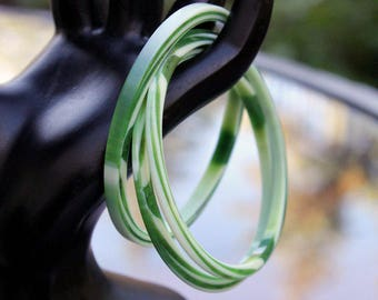 Three Green and White Moire Lucite Bangles by Best Plastics, ca. 1960s