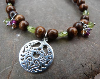 Necklace wood beads and gemstones silver bird pendant