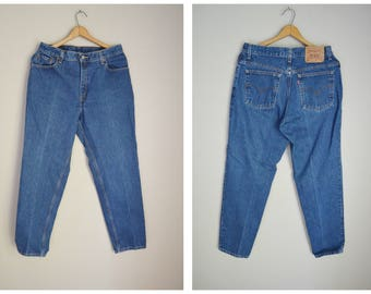 vintage dark wash 90s 550 Levi's - high waisted-- tapered leg -- womens 32x31