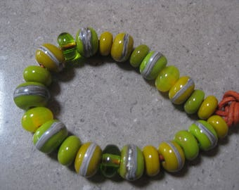 Lampwork Glass Beads. Lemons and Limes. Green, Yellow and Silver Ivory Beads. Handmade Glass Beads. Australian Artisan Beads. Kiln Fired.