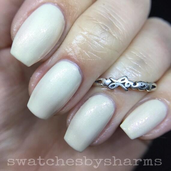 Blood Moon Nail Polish cream with peach shimmer vegan