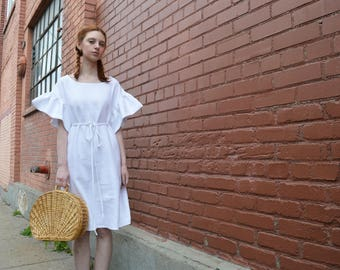 White linen ruffle dress