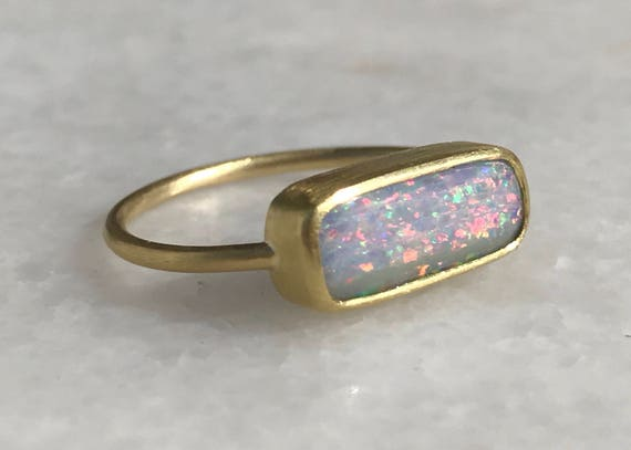 Solid Boulder opal and solid 22k gold ring