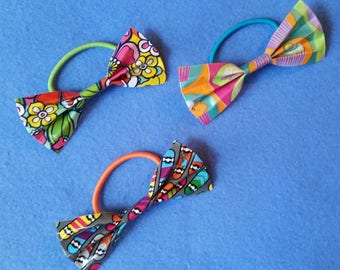 Handmade Duct Tape Hair Bow Hair Tie, mod flowers, cupcakes, or skateboards, upcycled duct tape bow hair elastic