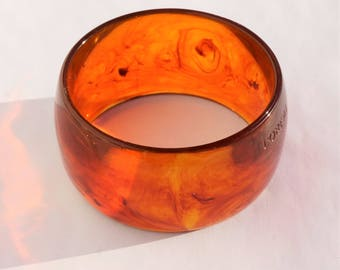 BANGLE, BROWN, ROOTBEER,  signed translucent brown bangle, signed L'Oreal, beautiful brown bangle that comes to life in sunlight
