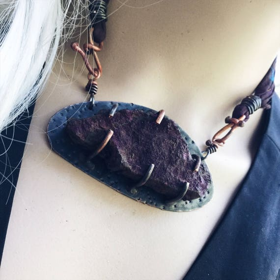Natural raw and rare puple purpurite stone prong set on blackened copper with sari textile