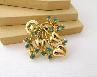 Vintage Blue Rhinestone Gold Tone Nouveau Style Leaf Vine Flower Brooch Pin
