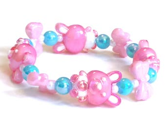 Pastel Pink Iridescent Bunny and Bow Stretch Bracelet with Blue and White Pearl Beads