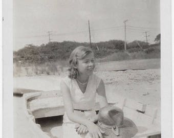 Old Photo Teen Girl on Beach Sitting in Boat wearing Dress Holding Hat 1930s Photograph Snapshot vintage Ocean View Fl