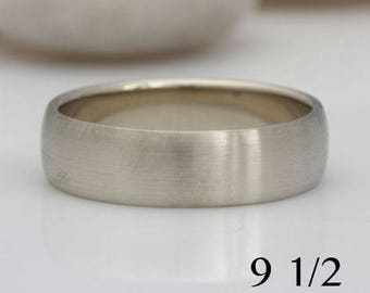 14k white gold band, size 9 1/2 or custom sizes, with a slightly domed and brushed surface, #454.