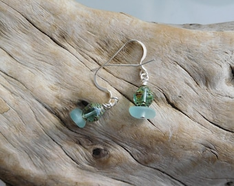 Genuine sea glass earrings.  Dark aqua with a Czech glass bead.  Sterling Silver French wires.  Hand gathered and un-altered beach glass