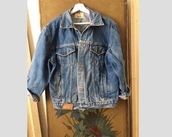 L/ Women Levis Distressed Faded blue denim jacket