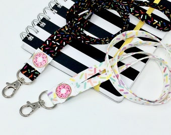Donut Lanyard with Sprinkles, exclusive design keeps your badge holder laying flat, soft comfortable cotton fabric, choice of black or white