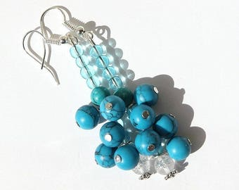 Silvered earrings with clusters of Turquoise and sky blue and transparent glass beads