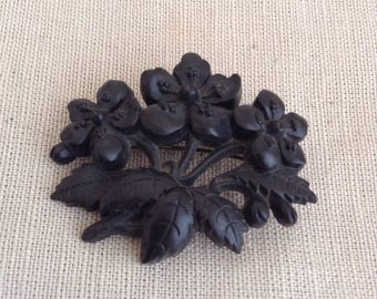 XIX's black floral brooch.