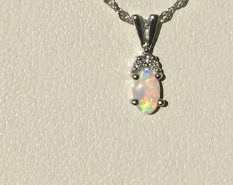 14k white gold opal and diamond pendant and rope chain