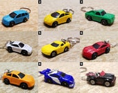 Micro Machines - Necklaces, Keychains, Cell Phone Charms, Audio Jack Plugs & Chokers - Hot Wheels