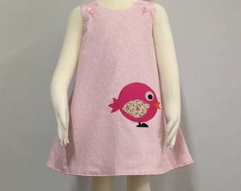 Girls reversible pale pink polkadot Birdy pinafore dress