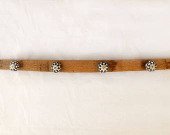 wall coat rack with vintage style knobs on a repurposed wine barrel stave, rustic decor