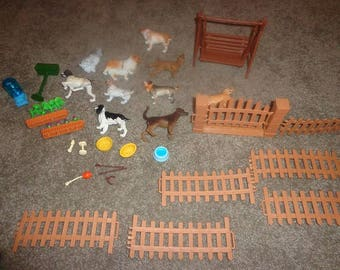 Toy playset,Dog park with dogs,fencing,water bowls,collie,other dog breeds