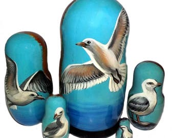 Seagull on Five Russian Nesting Dolls. Ocean Life.
