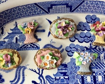 Choice of charming, handpainted floral brooches from mid-century