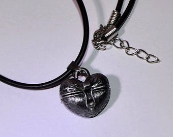 Treasure/secrets metal grey on black rubber cord necklace