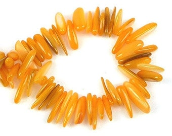 Mother of Pearl irregular beads yellow orange 5-20 mm - sold by 20