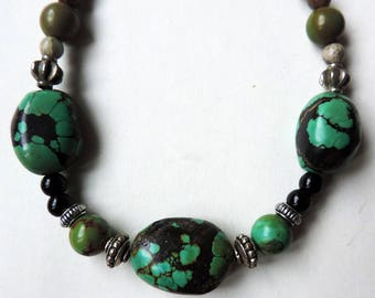Necklace gemstones: Turquoise and volcanic lava.