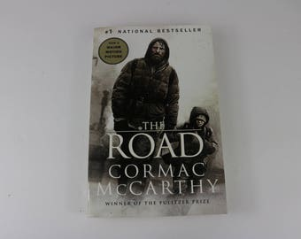 the journey in the road by cormac mccarthy 03-06-2009 best answer: first give an introduction the road is a 2006 novel by american writer cormac mccarthy it is a post-apocalyptic tale of a journey taken by a father and his young son over a period of several months, across a landscape blasted by an unnamed cataclysm that destroyed all civilization and, apparently, most life on earth.