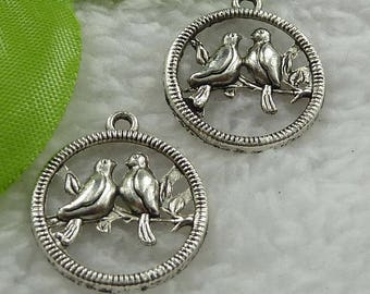 X 2 pair of birds in Tibetan Silver Circle 23 mm