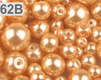 62 B - 100 g of 4-12 mm glass pearl beads different sizes