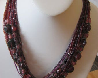 Bead & seed bead multi strand vintage necklace, cranberry and purple beads, silver accents