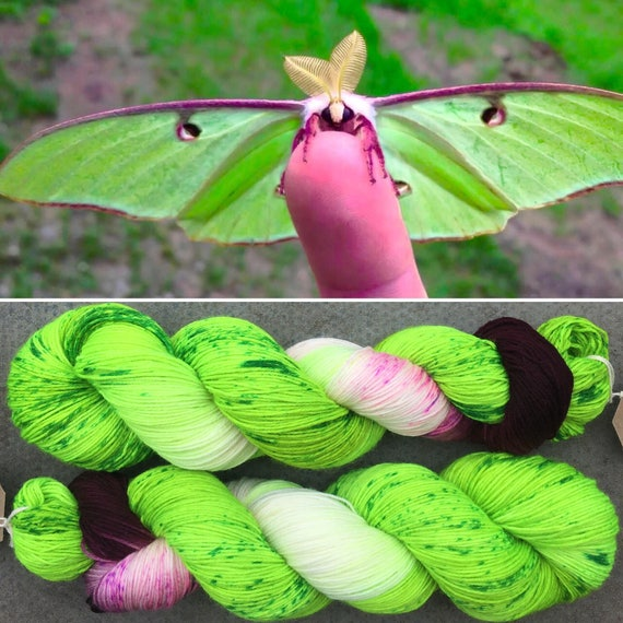 Luna Moth BFL, green purple 75/25 Bluefaced Leicester nylon UV reactive speckled sock yarn