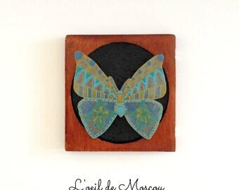 Butterfly on black chalkboard
