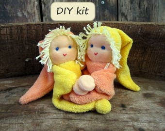Do it yourself kit '2 Noesjes', for making 2 dolls with magnetic hands. Color: yellow - orange